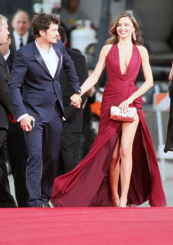 Miranda Kerr and Orlando Bloom made a glamorous red carpet entrance hand in hand.