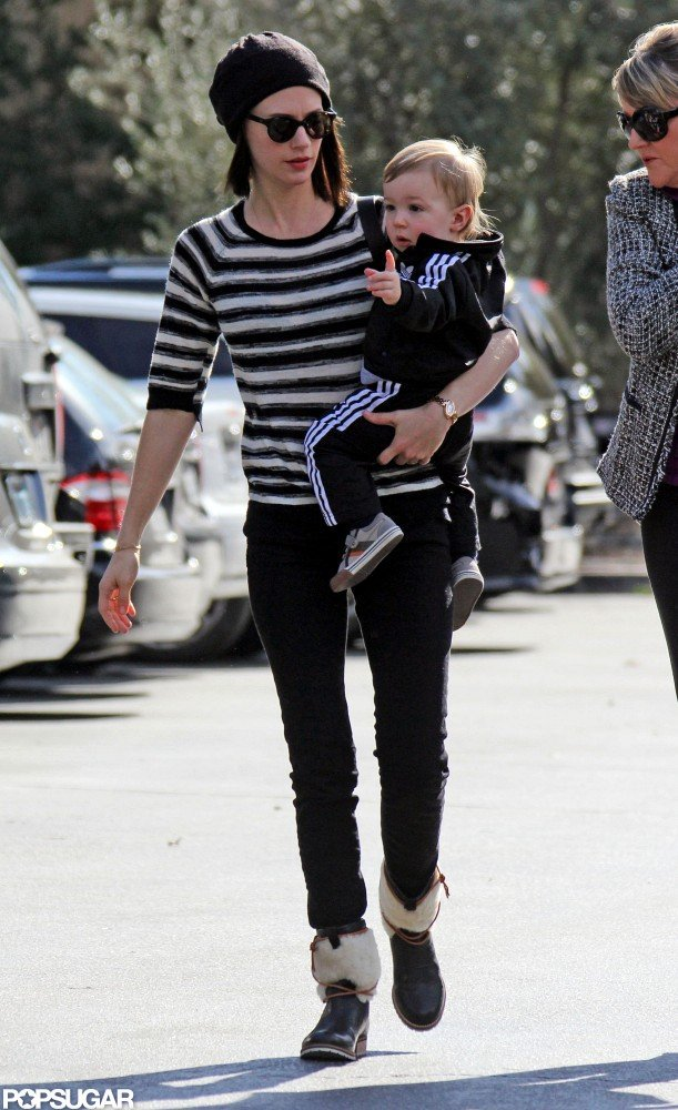 January Jones held Xander as she headed out to eat in LA.