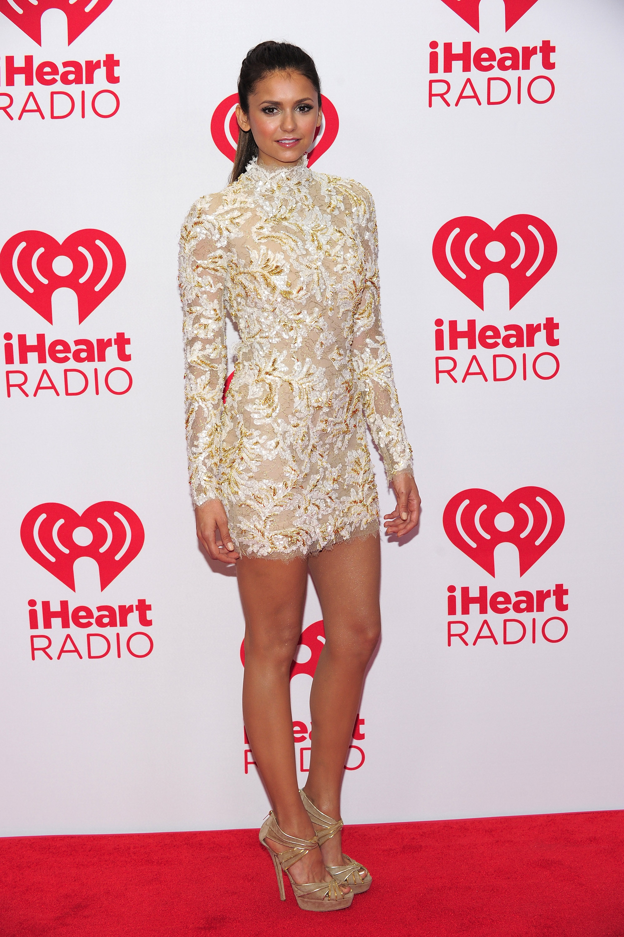High-necked but so, so sexy — that's what Nina is giving us with her Zuhair Murad Couture mini at the 2012 iHeartRadio Music Festival.