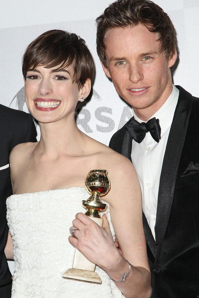 Eddie Redmayne posed up close to Anne Hathaway.