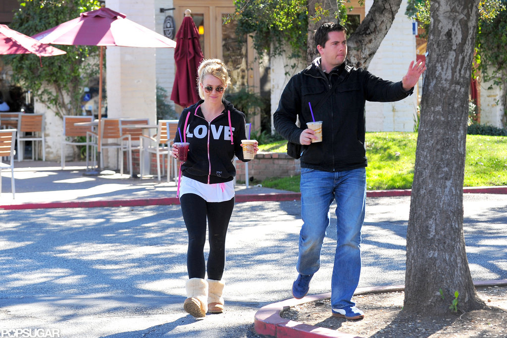 Britney Spears walked with a bodyguard.