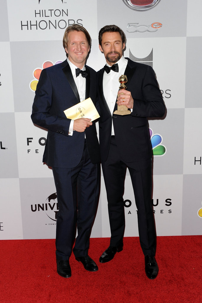 Hugh Jackman and Tom Hooper posed together.