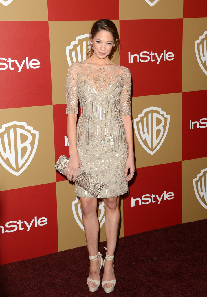 Analeigh Tipton showed off her pins in a sheer, shimmery minidress with chunkier ankle-strap heels.