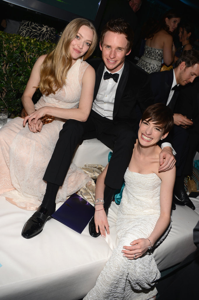 Les Misérables stars Amanda Seyfried and Eddie Redmayne joined Anne Hathaway at a Golden Globes afterparty to celebrate her win for best supporting actress in a motion picture.