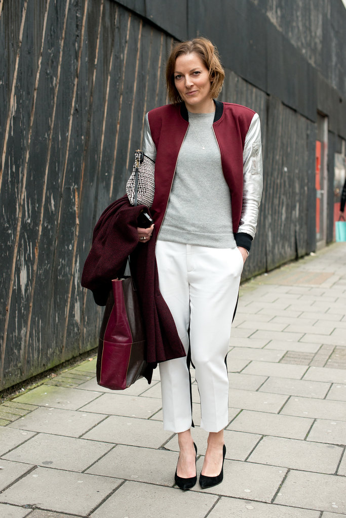 A varsity jacket and tuxedo-stripe pants gave a basic top a sporty twist.