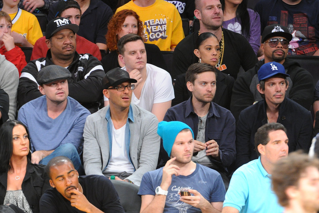 Leonardo DiCaprio watched the game with actors Tobey Maguie and Lukas Haas.