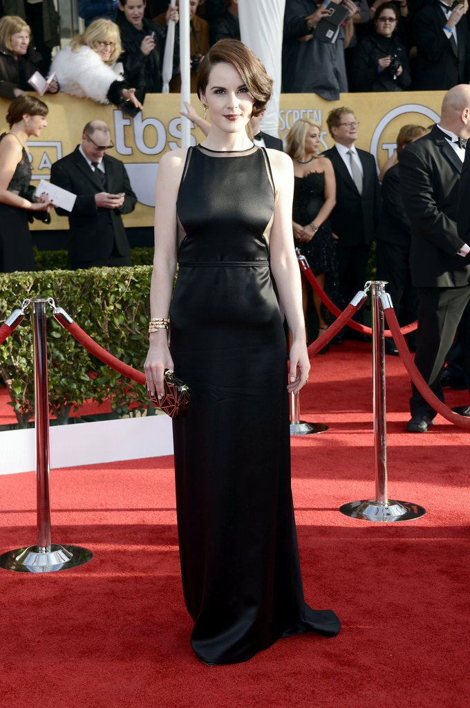 Michelle Dockery went vintage in a Ralph Rucci gown, complete with sheer panels.