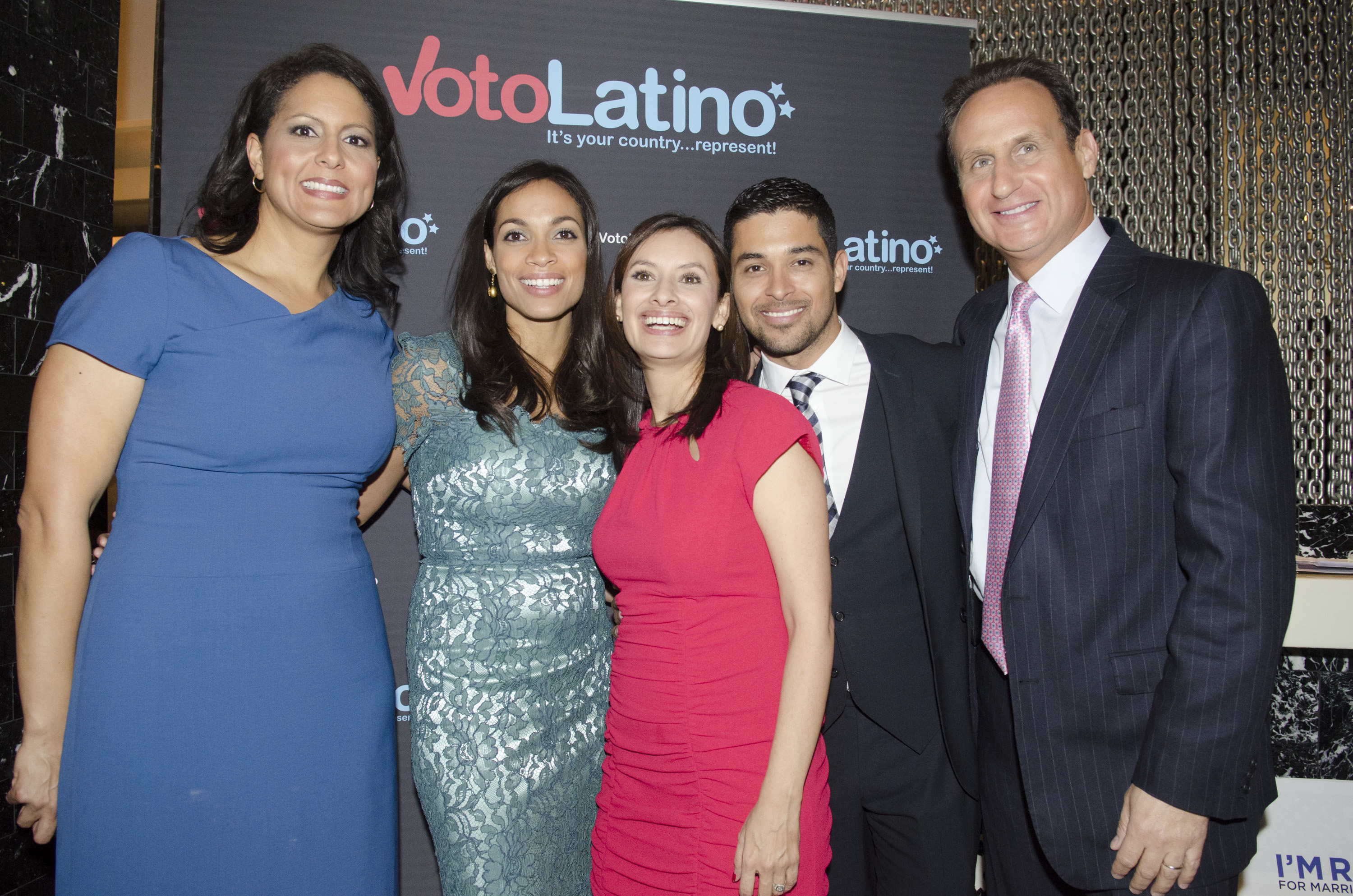 Rosario Dawson and Wilmer Valderrama posed for pictures with Voto Latino board members and journalists Sunday.