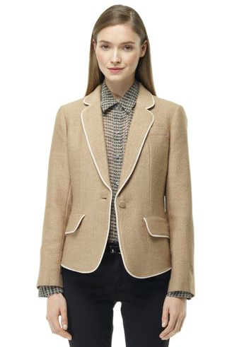Club Monaco's piped camel blazer ($199, originally $259) would instantly polish up any of your ensembles. We appreciate the mix of camel and white.