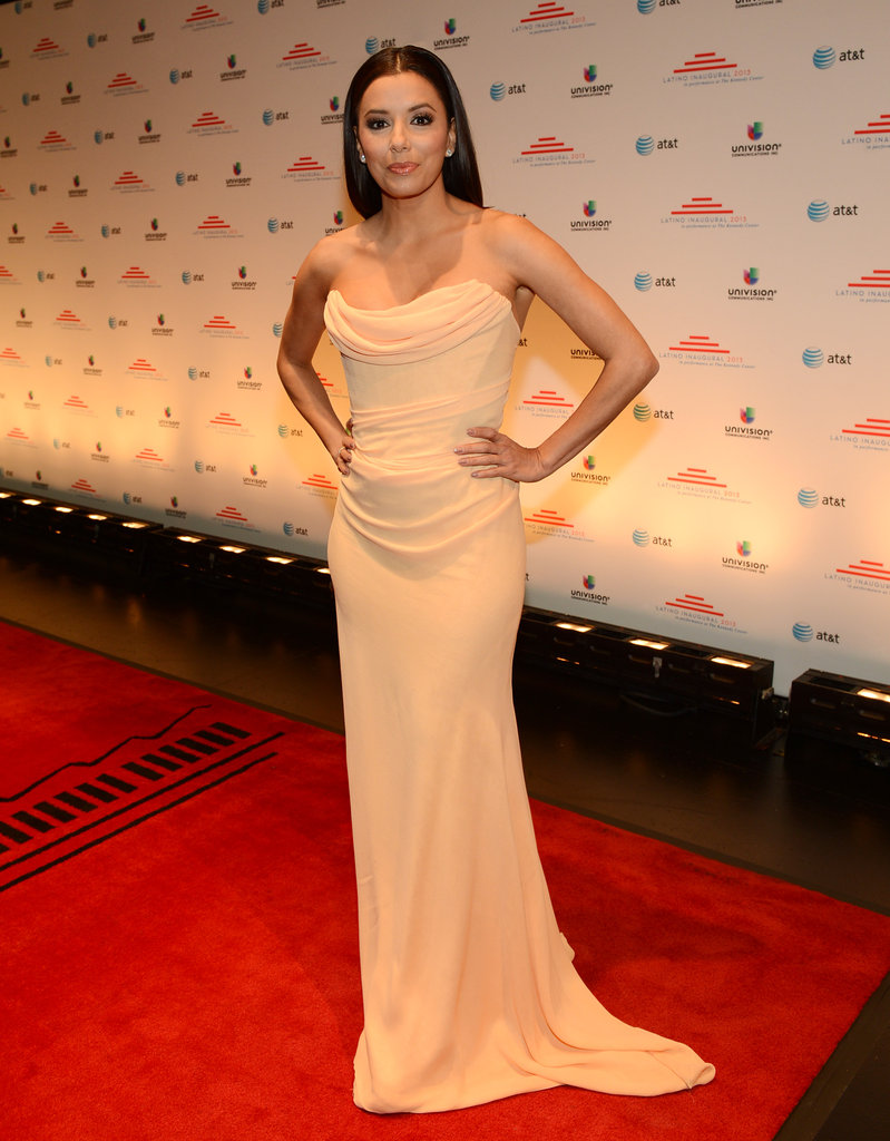 Eva Longoria made an appearance at the Latino inaugural celebration wearing an elegant strapless gown featuring a draped bodice.