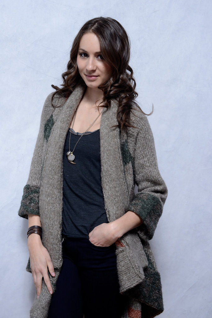Troian Bellisario worked the camera in a knitted wrap cardigan and charm necklace.