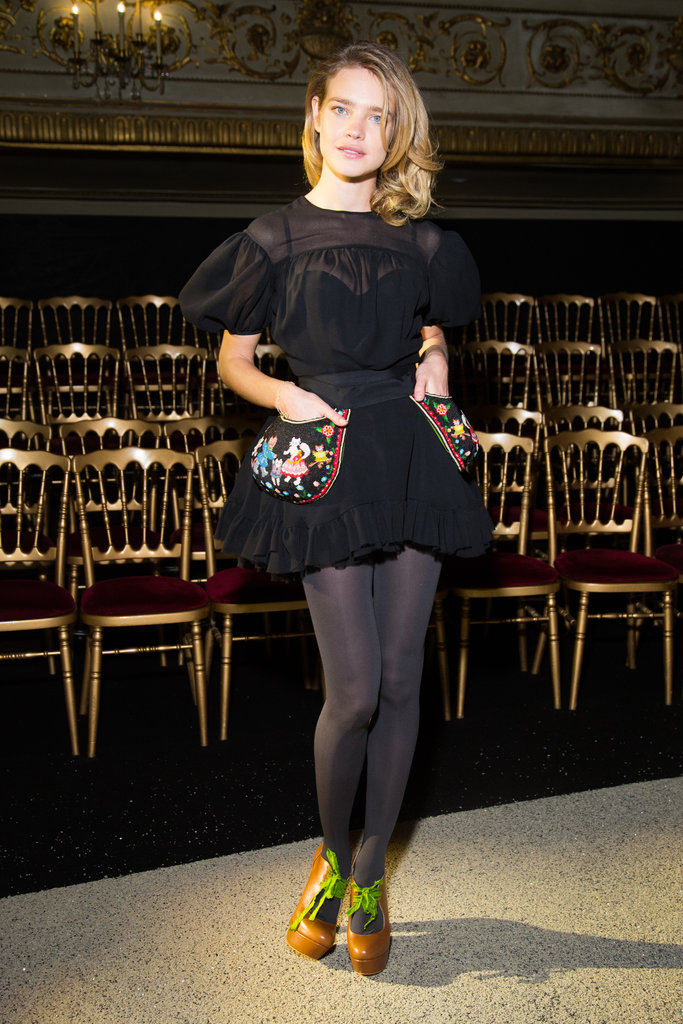 Natalia Vodianova posed in a ruffly little black dress with cool embroidered pockets.