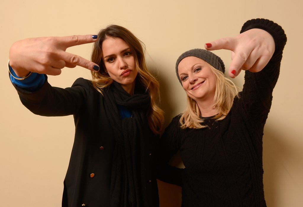 Jessica Alba and Amy Poehler threw up peace signs while at Sundance.