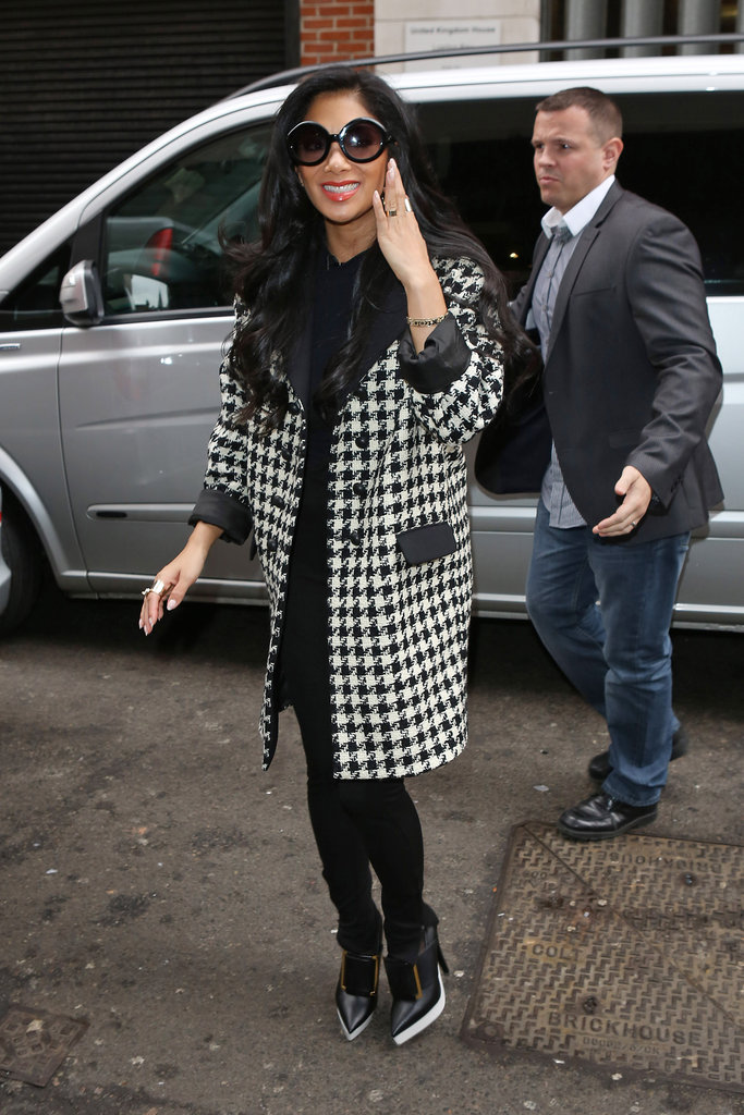 Nicole Scherzinger's London look was all about her black-and-white houndstooth coat. Her white-soled booties weren't too shabby either.