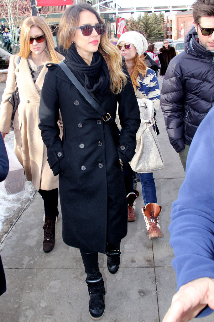 Jessica Alba strolled Park City in a Tory Burch trench coat, coated denim, and high-top sneakers.