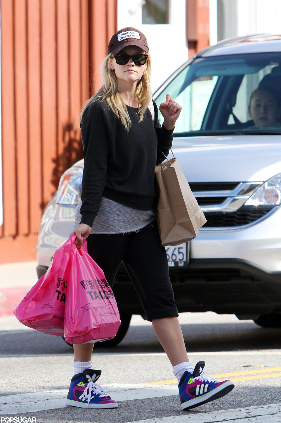 Reese Witherspoon Opts For Takeout Amid a Busy Award Show Night