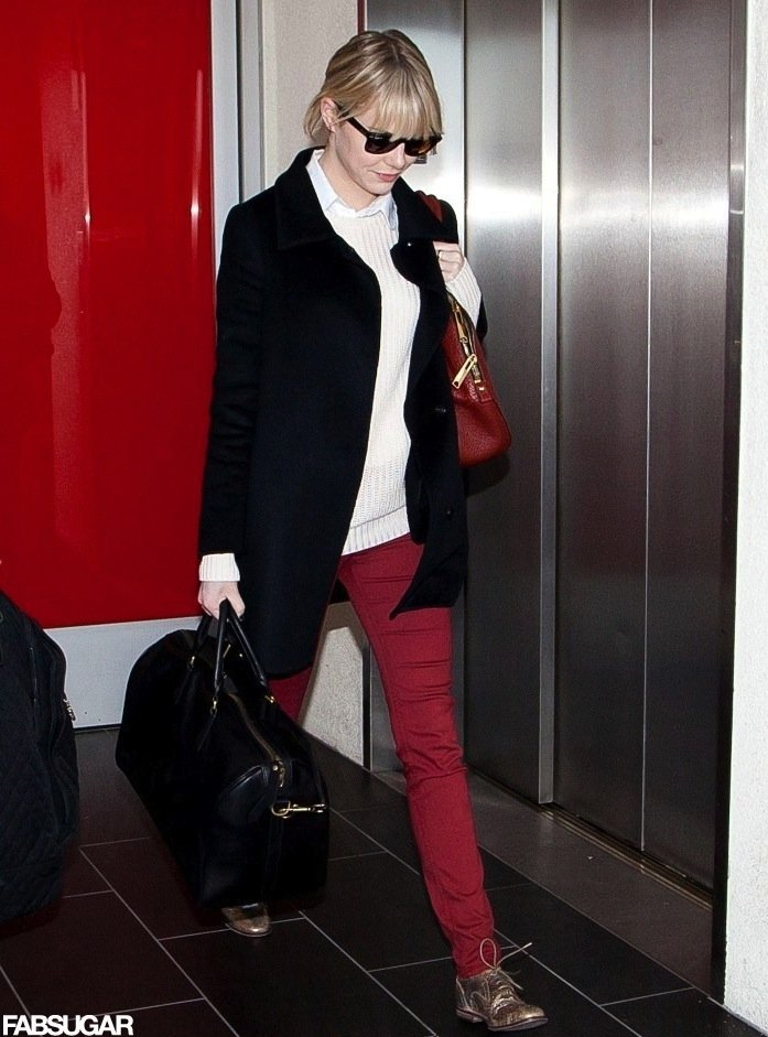 Emma Stone's cold-weather style got a jolt of color and a hint of shine thanks to her red skinny jeans and gold oxfords.