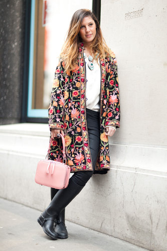 As far as statement coats go, this embroidered, floral version was pretty major, but she pulled it off with a basic tee, skinnies, and boots. Source: Adam Katz Sinding