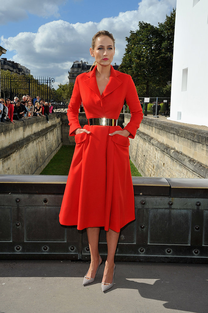 Leelee Sobieski opted for something a bit dramatic for her appearance at the Christian Dior show in Paris, wearing a bright red trench-coat-turned-dress with a high-shine waist belt.