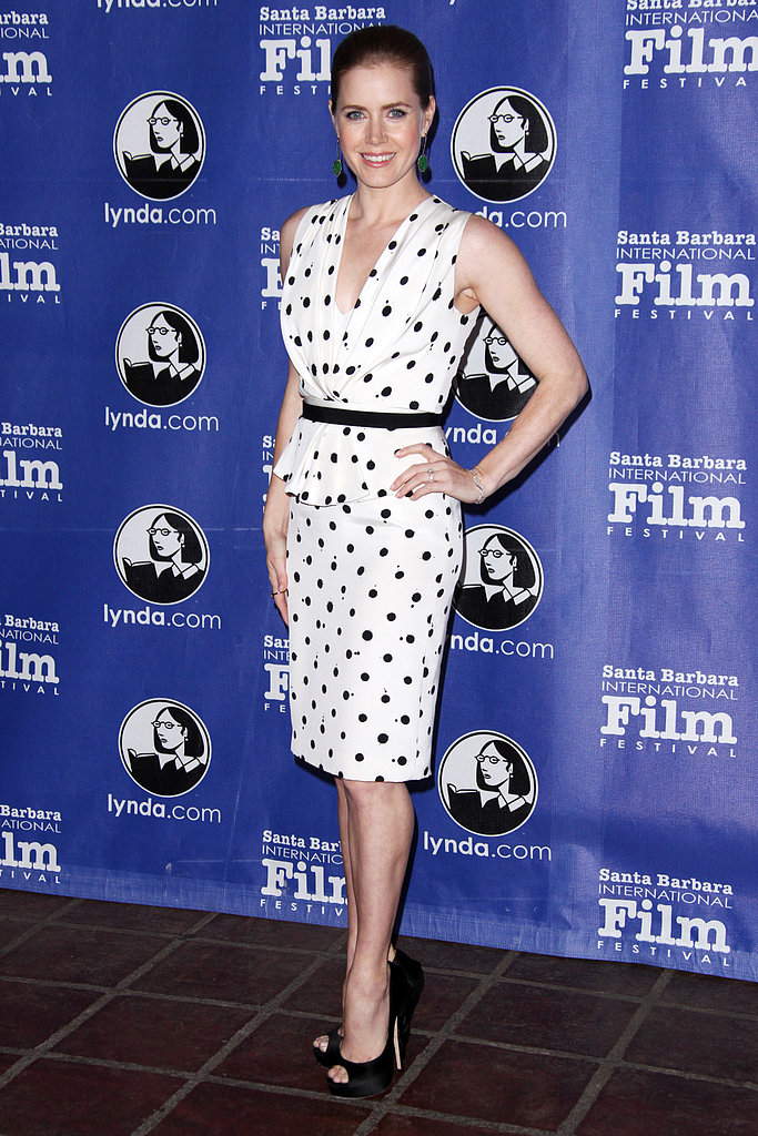 Amy Adams selected a Jenny Packham v-neck polka-dot peplum dress from the designer's Spring 2013 collection and Jimmy Choo peep-toes for the 2013 Santa Barbara Film Festival.