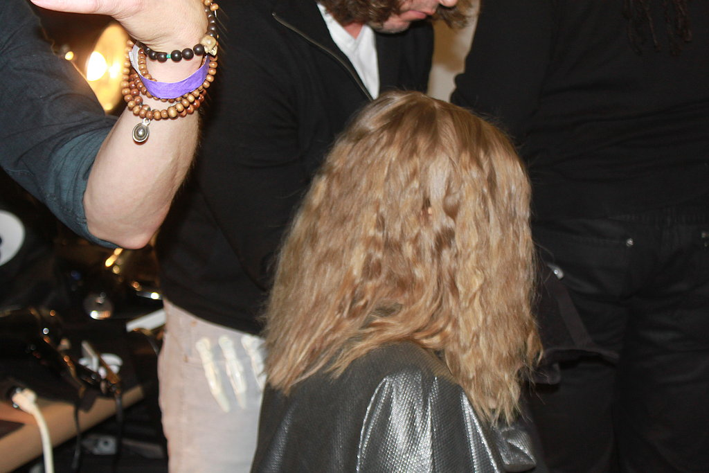 """Once cool, hair was released and brushed out to form textured waves that were then secured behind each ear. """"The look here is bohemian minimalism. There are a lot of architectural shapes and a lot of texture in the fabrics that he used in the collection,"""" Pita said. """"So we tried to get that in the hair, so we're playing with the really defined and the kind of romantic bohemian."""""""