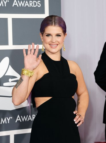 Kelly Osbourne gave the crowd a wave on the red carpet.