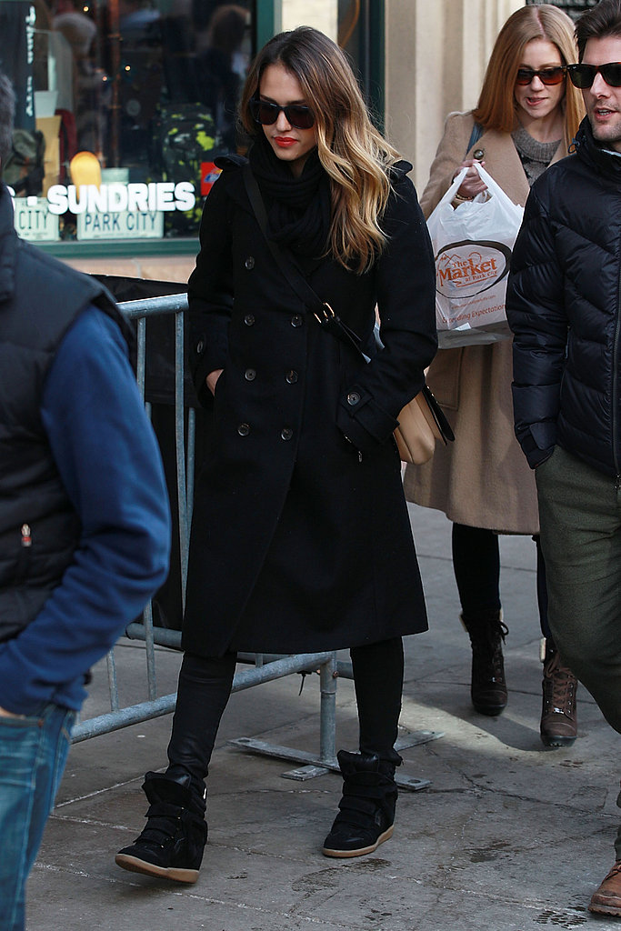 Jessica Alba bundled up in a black double-breasted coat, black jeans, and black Isabel Marant sneakers at Sundance.