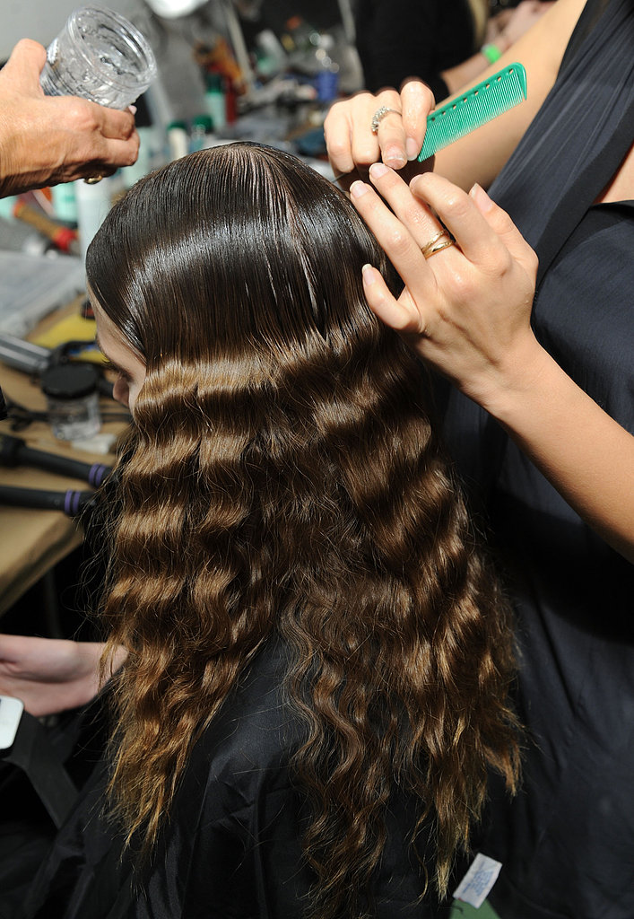 """She started by flattening the top of the hair down with Kérastase Ciment Reconstructor Milk to give it some """"flat volume."""""""