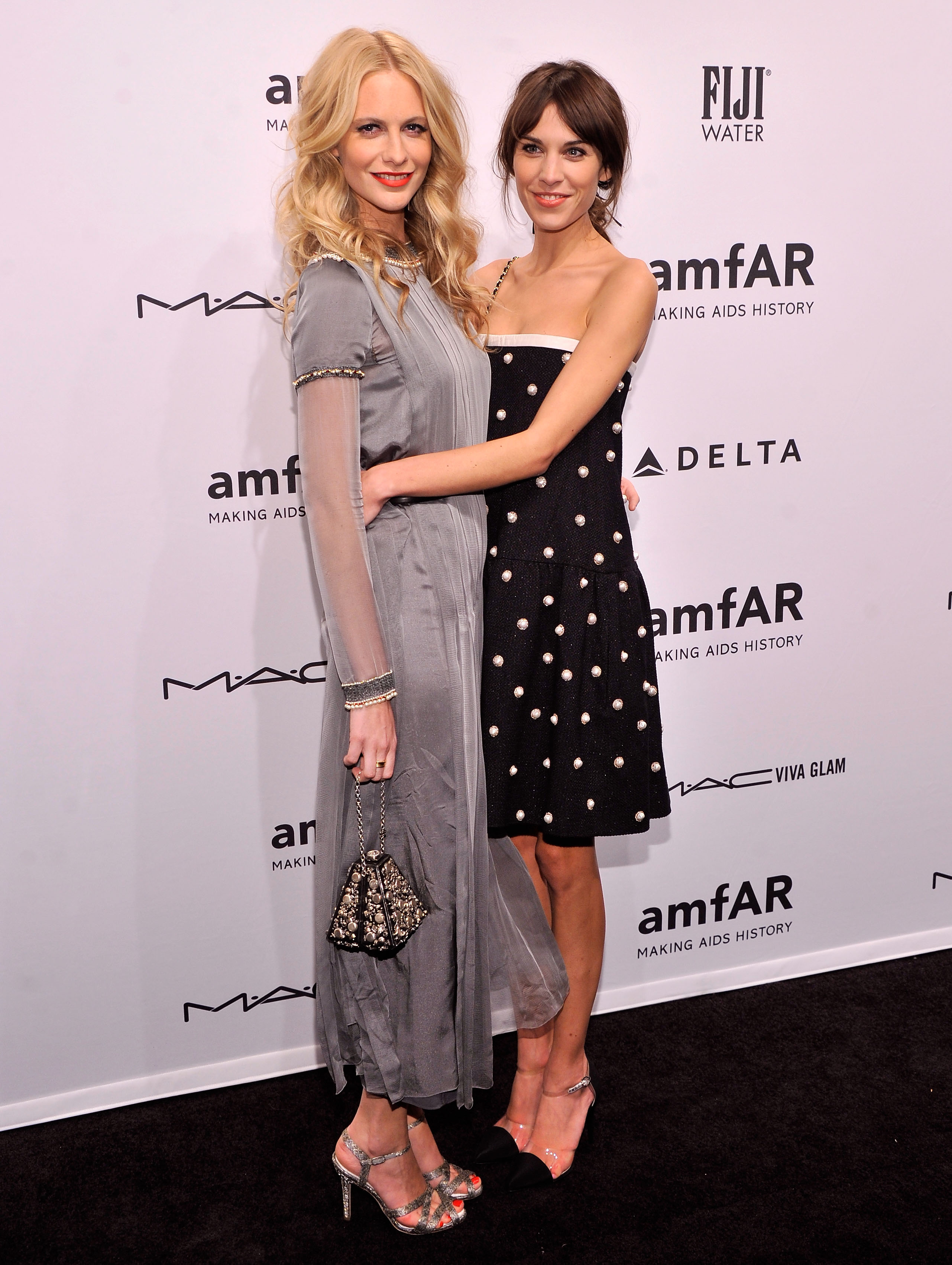 Alexa Chung hugged friend Poppy Delevingne at the amfAR New York Gala on Wednesday.