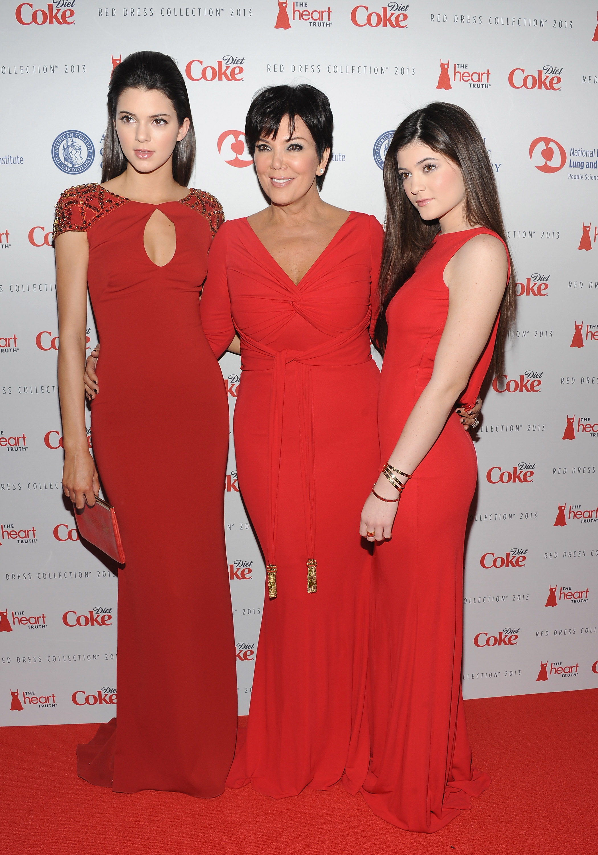 Kris Jenner posed with her daughters Kylie Jenner and Kendall Jenner before they all walked down the runway for The Heart Truth's Red Dress Collection fashion show on Wednesday.