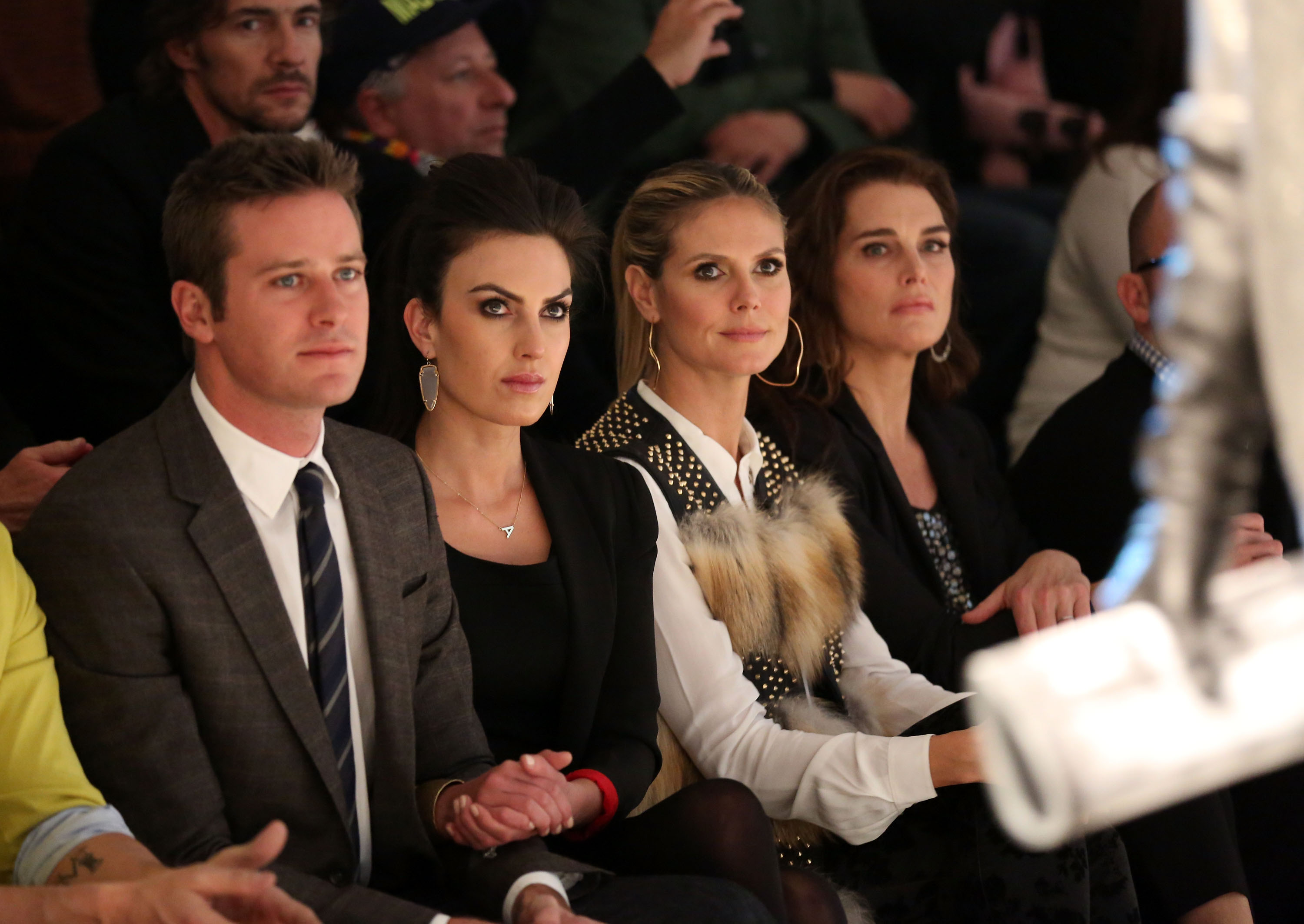 Armie Hammer and Elizabeth Chambers sat next to Heidi Klum and Brooke Shields in the front row at Kenneth Cole&#0