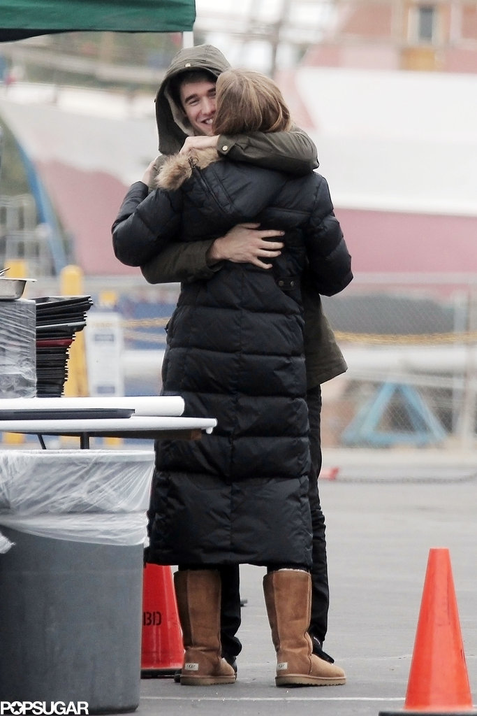 Joshua Bowman hugged Emily VanCamp while on set on Thursday.
