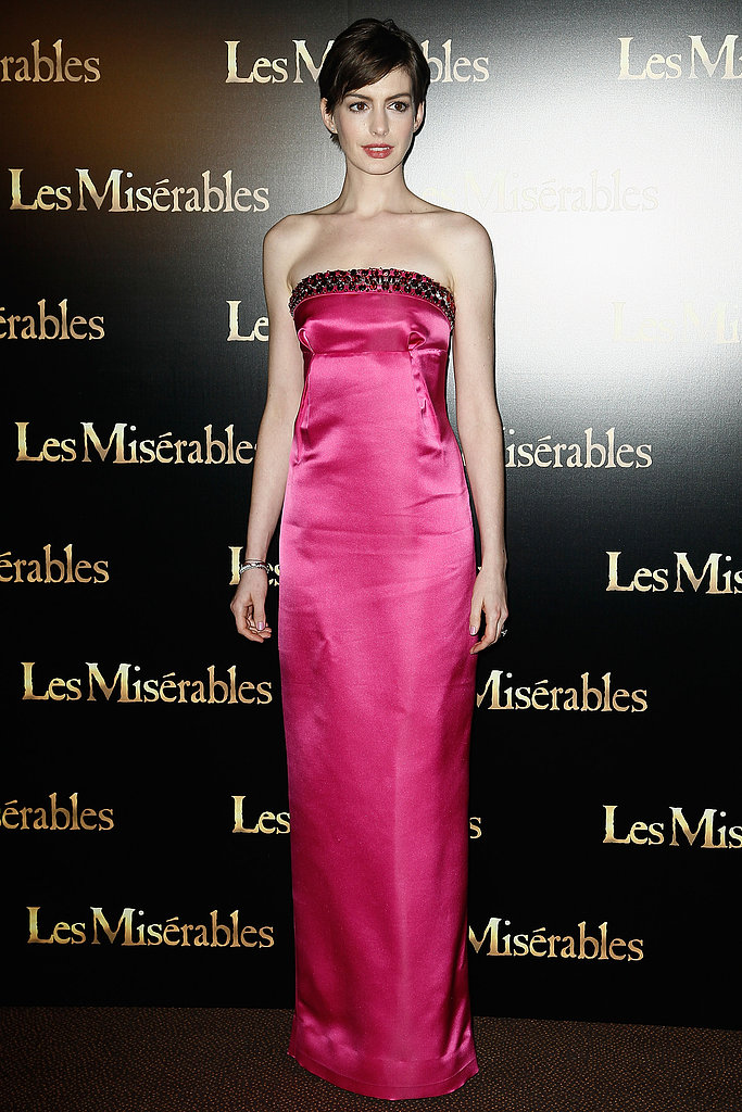 leAnne Hathaway opted for bright pink when she attended the Les Mis premiere at the Avenue Du Cinema Festival in Paris on February 6.