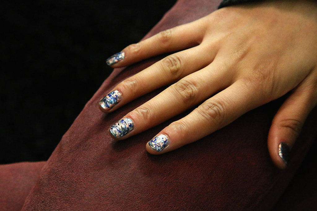"""Lead manicurist Michelle Saunders for Essie created the oil-slicked nail design. """"Rebecca Minkoff said that she wanted the nails to have an oil-slick effect, which was inspired by her handbags in the collection,"""" she said."""