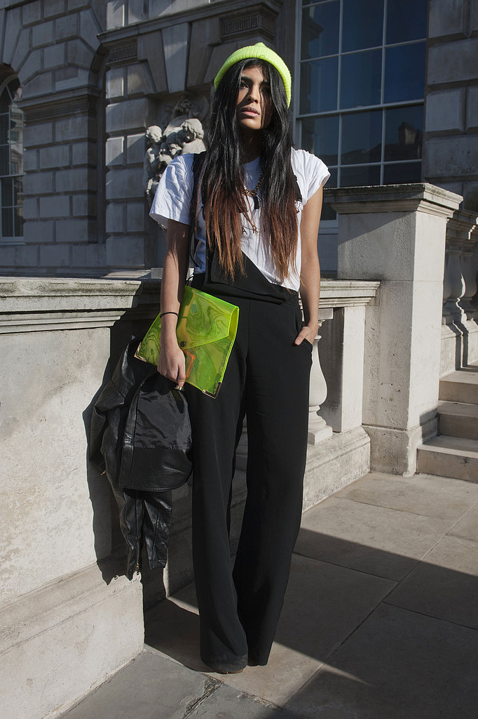 Neon accents livened up black overalls.