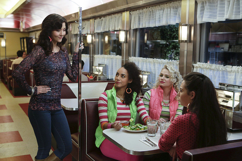 Jen and Jen doubled up on stripes and colorful puffer vests while chatting with Maggie and Chloe at the diner. Stay toasty and trendy all Winter long in this pink puffer vest by Lilly Pulitzer ($188). Source: The CW