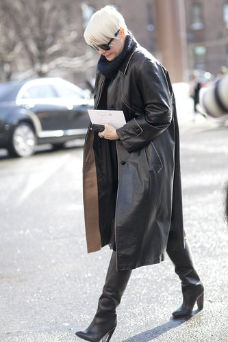 Kate Lanphear pulled a leather trench over an understated Winter look.
