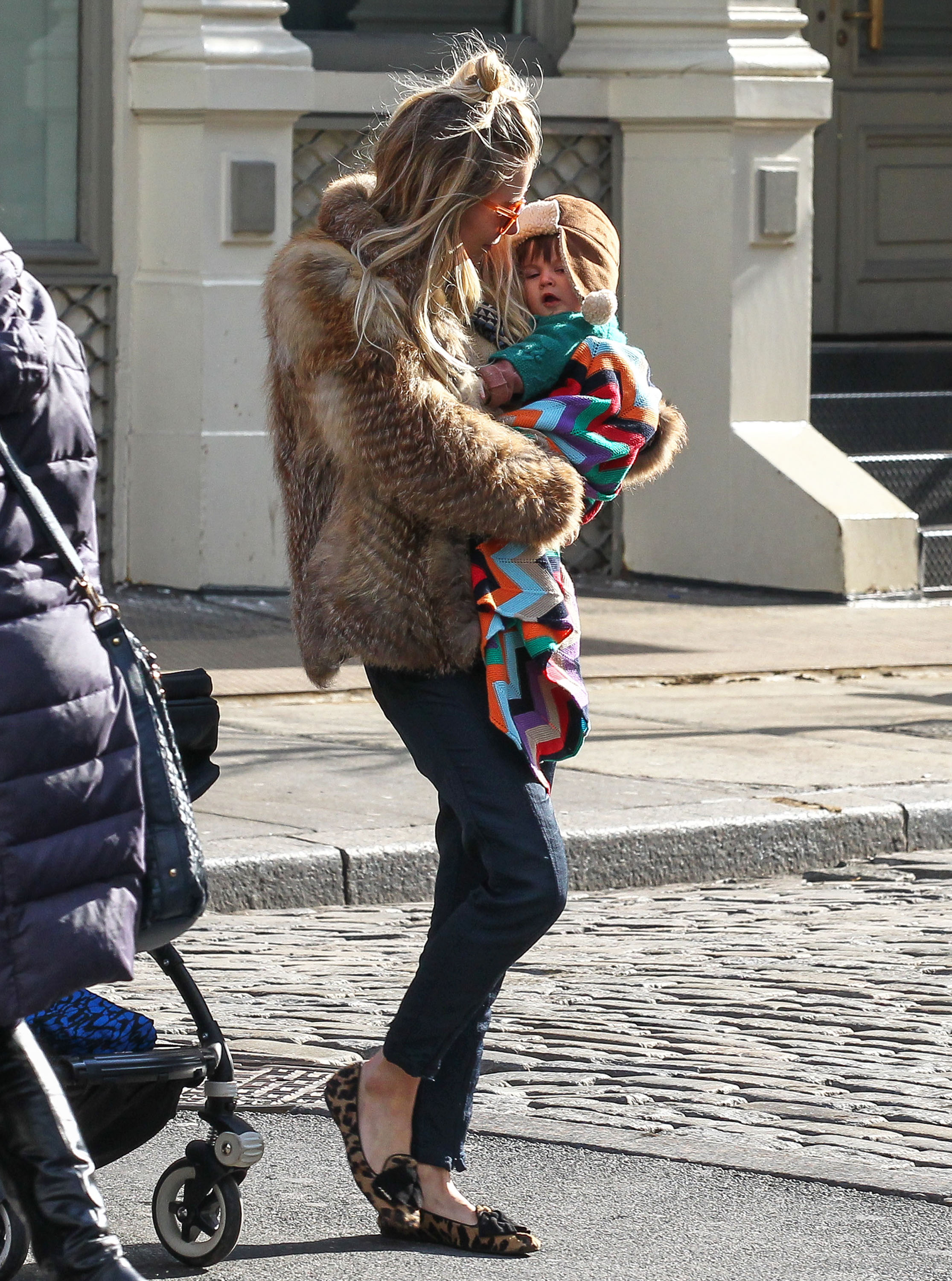 Sienna Miller carried her daughter, Marlowe Sturridge.