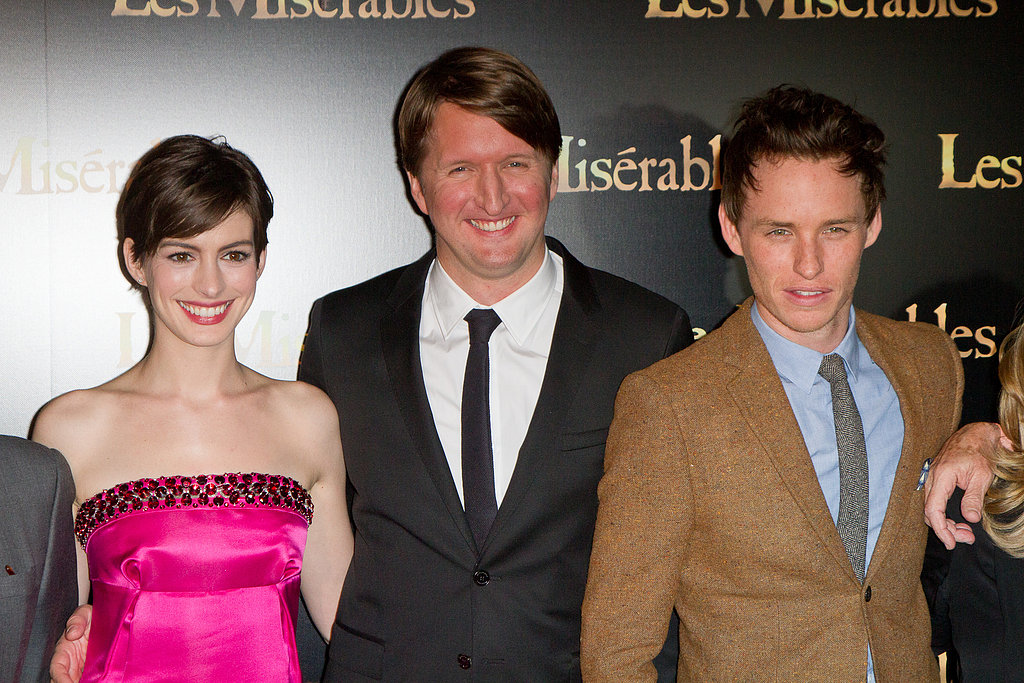 Director Tom Hooper was all smiles with Anne Hathaway and Eddie Redmayne at the Paris premiere.