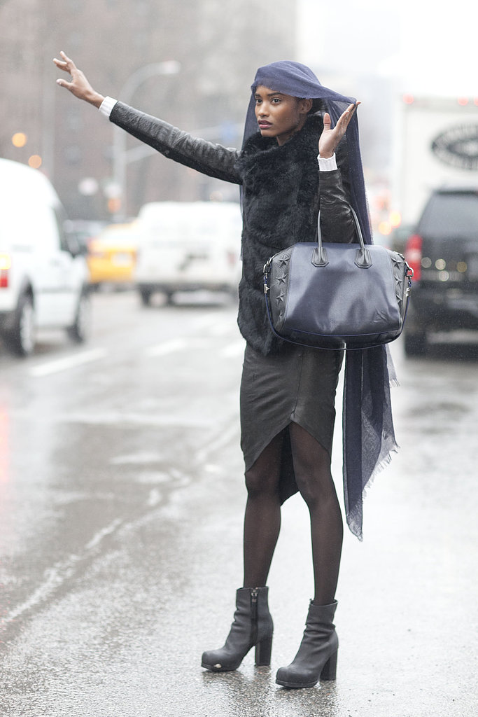 Even caught in the rain, this showgoer managed to stay stylish with a richly hued Givenchy bag.