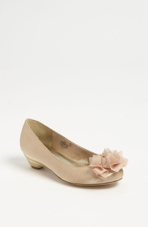 A gold pump ($56) with a kitten heel is fancy but comfortable to keep her going even through the afterparties.