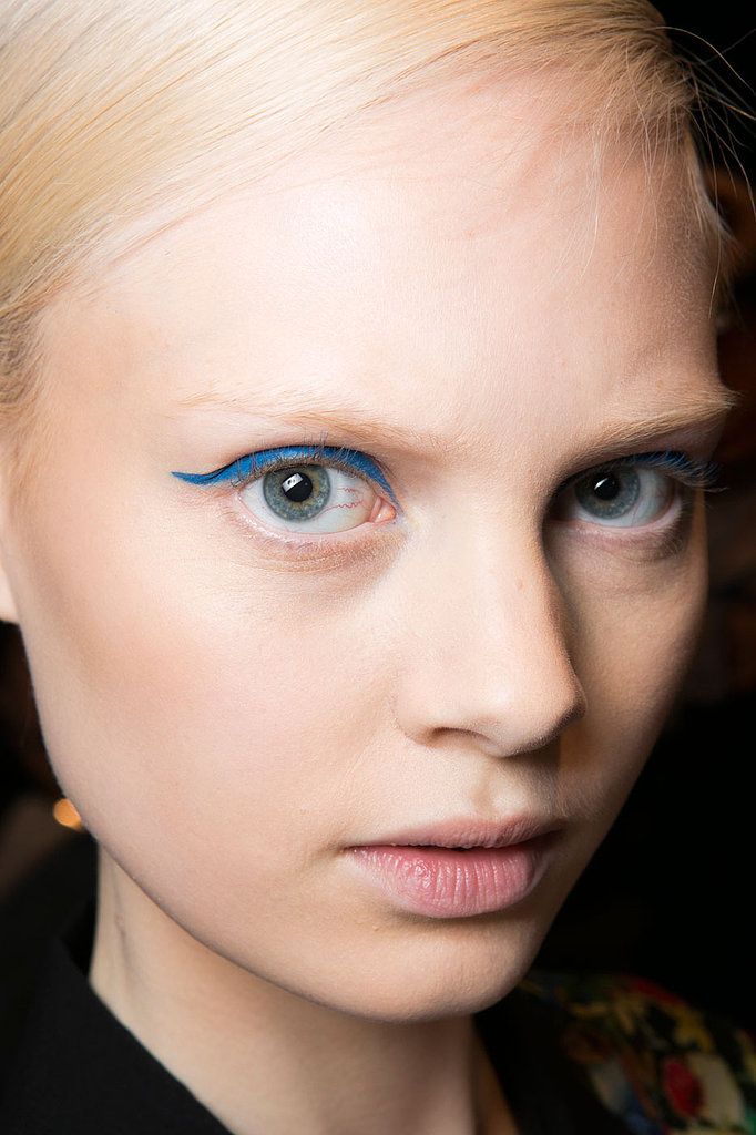 """For the liner, Stila lead stylist Adrien Pinault for Beauty.com wanted something that was more graphic to go along with the colorful collection. """"We started with extremely soft, glowing skin and then opted for a straighter cat eye."""""""