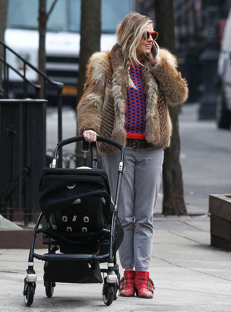Sienna Miller sported a heavy fur coat.