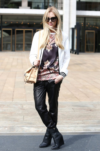 A rich print on her tee contrasted perfectly with slick leather bottoms.