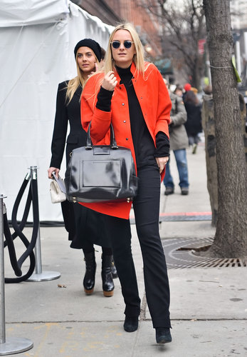 Red-hot hues on her coat livened up her black top and pants.