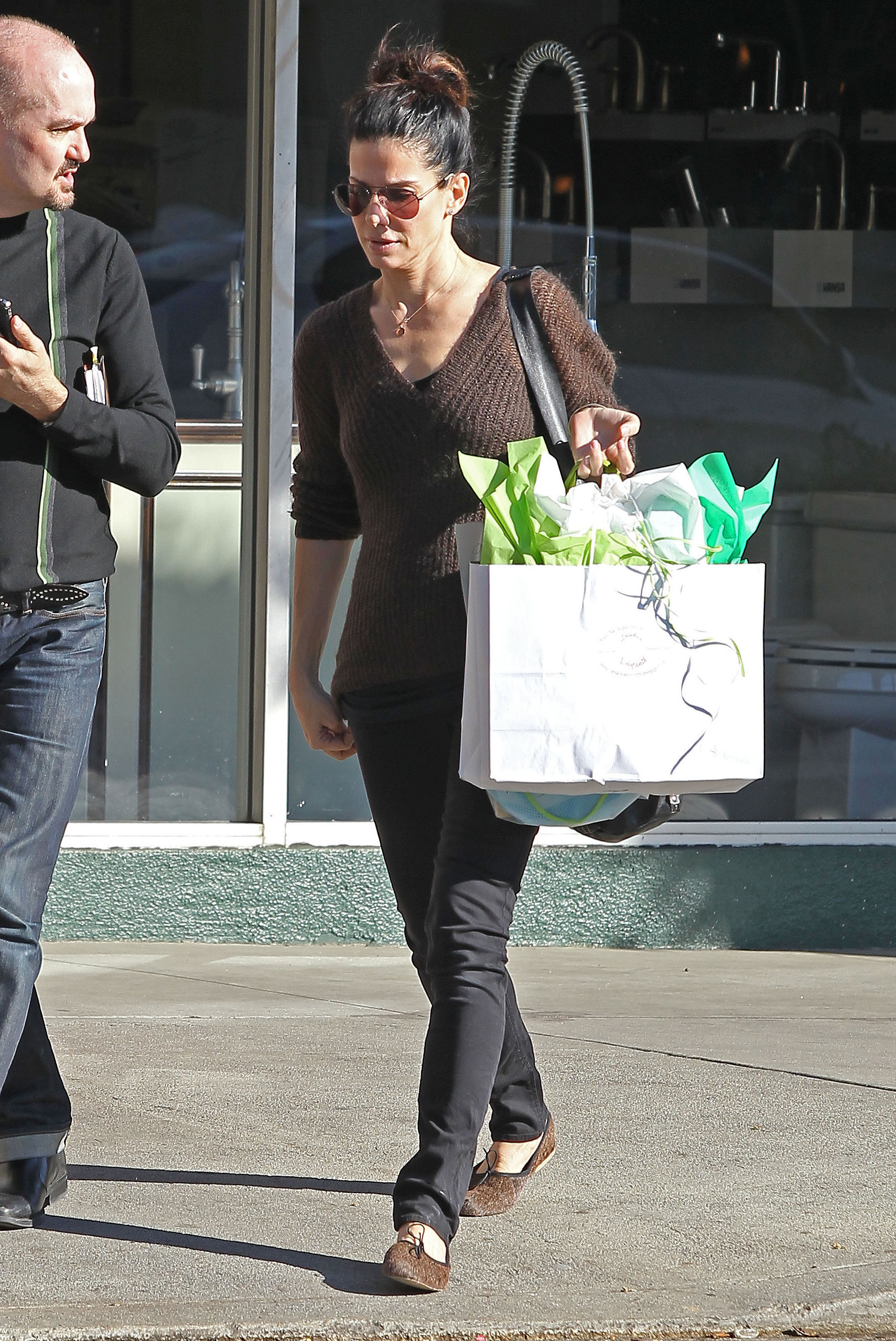 Sandra Bullock donned a casual pair of flats in LA.