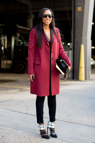Shiona Turini dressed up her trousers with a cranberry coat and a pair of ultrachic black and white heels.