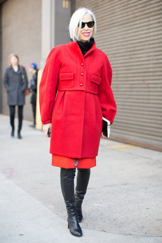 Linda Fargo brightened her basic black with shades of red.