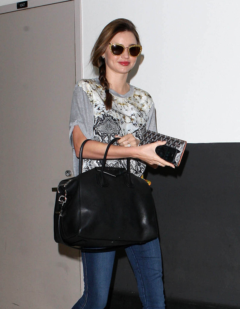 Miranda Kerr arrived at LAX with a smile on her face.