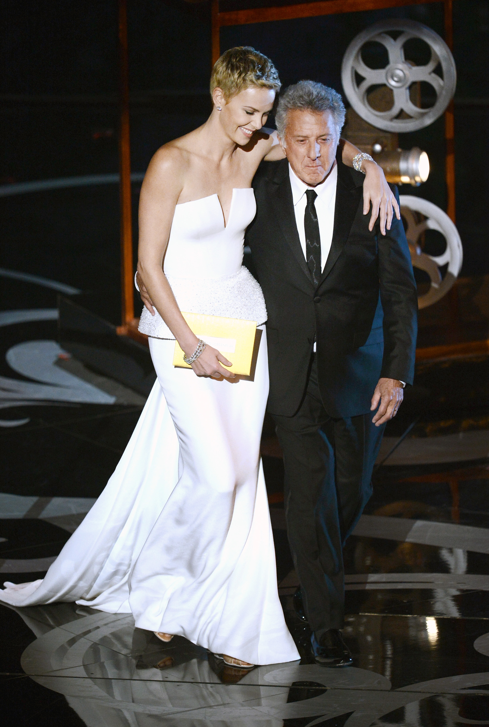 Charlize Theron hugged Dustin Hoffman on stage.